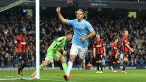 Manchester City's Martin Demichelis celebrates scoring his side's third goal of the game