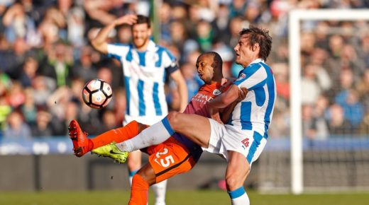 Manchester-Citys-Fernandinho-in-action-with-Huddersfield-Towns-Dean-Whitehead