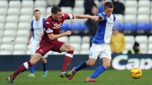 Birmingham City's Emyr Huws (right) is tackled by Derby County's Craig Forsyth during the Sky Bet Championship match at St Andrews, Birmingham. PRESS ASSOCIATION Photo. Picture date: Saturday February 1, 2014. See PA story SOCCER Birmingham. Photo credit should read: Clint Hughes/PA Wire. RESTRICTIONS: Editorial use only. Maximum 45 images during a match. No video emulation or promotion as 'live'. No use in games, competitions, merchandise, betting or single club/player services. No use with unofficial audio, video, data, fixtures or club/league logos.